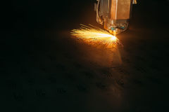 Laser cutting machine cuts the metal with sparks. Industry Royalty Free Stock Photography
