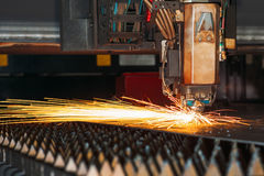 Laser cutting machine cuts the metal with sparks. Industry Stock Photography