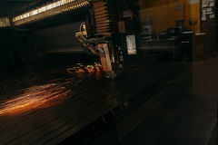 Laser cutting machine cuts the metal with sparks. Industry Stock Image