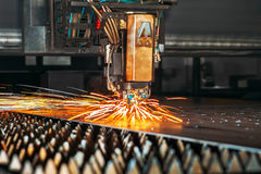 Laser cutting machine cuts the metal with sparks. Industry Stock Images