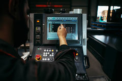 Laser Cutting Machine During operation controlled by Technician. Industry Stock Photos