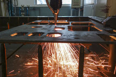 The laser cutting machine. While cutting the sheet metal with the sparking light Stock Photo