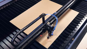Laser cutting machine for wood working with plywood. 4K. stock video footage
