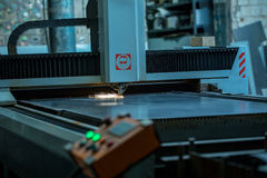 Laser cutting of metal. Automated machine Royalty Free Stock Images