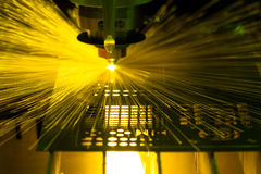 Laser cutting metal sheet. Sean of laser cut machine  working with spark laser beam in production line Stock Photos