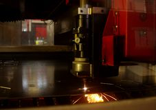 Laser cutting of metal sheet with sparks Stock Photo