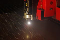 Laser cutting of metal sheet with sparks. Technical photo Stock Photography
