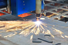 Laser cutting of metal Stock Photos