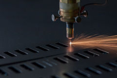 Laser cutting process. Process of industrial laser cutting of sheet metall Royalty Free Stock Photo
