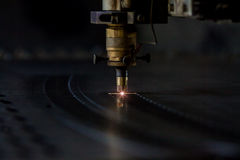 Laser cutting process. Process of industrial laser cutting of sheet metall Royalty Free Stock Images