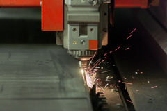 Laser cutting process. Process of industrial laser cutting of sheet metall Stock Photo