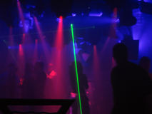 Laser Dancing. People in a club dancing with lights and lasers stock photography