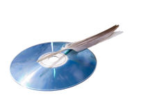 Laser disk and the bird's feather. Stock Images