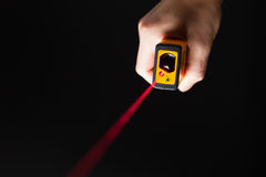 Laser distance meter in hand Stock Images
