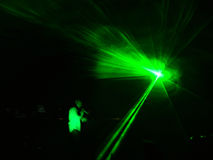 Laser effects on a DJ performance. A laser moving throught the stage on a DJ performance royalty free stock photos