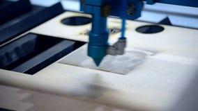 Laser engraving on wood. Laser engraving machine burning picture on wood board close-up. Laser cutting machine. Art Work. Process burning pattern on surface of