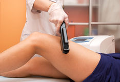 Laser epilation of leg Stock Images