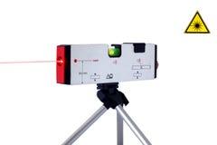 Laser-Hilfsmittel mit Lichtstrahl Stockbilder