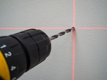 Laser level and lines on the wall. Lines of laser level on the wall for drilling Royalty Free Stock Image