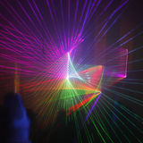 Laser light. Colored laser lights in the disco stock image