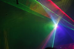 Laser light. Colored laser lights in the disco Stock Photos