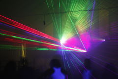Laser light. Colored laser lights in the disco royalty free stock image