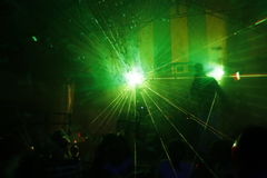 Laser light. Colored laser lights in the disco Royalty Free Stock Photos