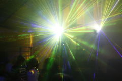 Laser light. Colored laser lights in the disco Stock Images