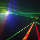 Laser light. Colored laser lights in the disco Royalty Free Stock Images