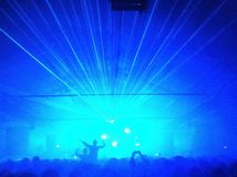 Laser lights during a festival. Blue lights for a show Royalty Free Stock Image