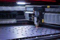 Laser machine cutting big sheet metal Royalty Free Stock Images