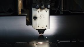 Laser machine cutting of sheet metal. Clip. Sparks fly from laser by automatic cutting CNC, PLC machine stock video