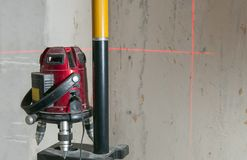 Laser measurement. Modern and efficient tools used for broken land, construction of buildings, decoration, installation of communications. Allow us to royalty free stock image