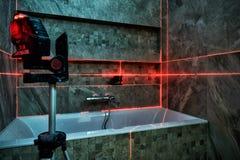 Laser measurement during renovation. Laser measurement during bathroom renovation Royalty Free Stock Image