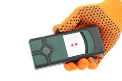 Laser measuring the level in hand with glove. Royalty Free Stock Image