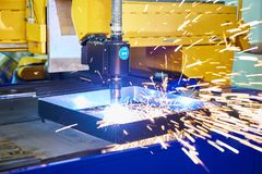 Laser metal cutting machine. And sparks stock images