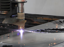 Laser metal cutting. Cutting metal sheet with a laser cutting tool Stock Image