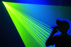 Laser party. Singer at club with green laser light Stock Images