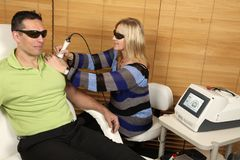 Laser physiotherapy Stock Photos