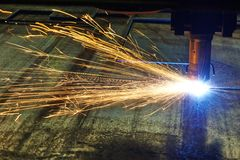 Laser or plasma cutting of metal sheet with sparks royalty free stock image