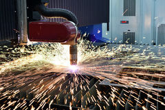 Laser or plasma cutting metalworking with sparks royalty free stock photo