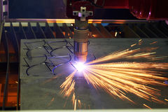 Laser or plasma cutting metalworking with sparks royalty free stock photography