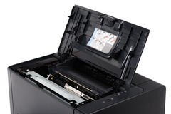 Laser printer with opened front cover. Black laser printer with opened front cover, isolated on white Stock Photo