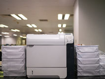 Laser printer and paper. In office Royalty Free Stock Images
