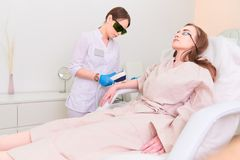 Laser procedure in the clinic of laser cosmetology royalty free stock photos