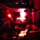 Laser processing. Processing of material with a power laser beam Royalty Free Stock Photo