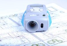 Laser range finder. On architectural printed plans Stock Photos