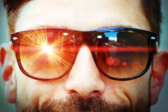 Laser ray on sunglasses Royalty Free Stock Images