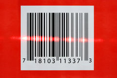 Laser reading a barcode Royalty Free Stock Image