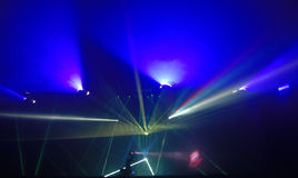 Laser Show. Colorful beams of light at a nightclub laser show stock images
